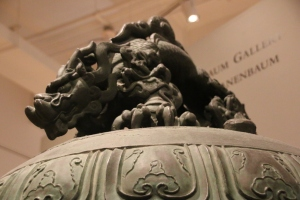 The top details of a bell displayed in the China gallery at the ROM.